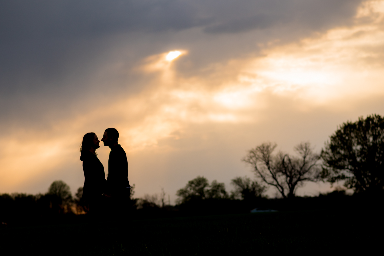 engagement-photography-session-focus-on-joy-photography-jessica-capozzola-gravelly-point-park-washington-dc-maroon-checkered-shirt-navy-sweater-husband-wife-fiance-engaged-couple-sunset-silhouette