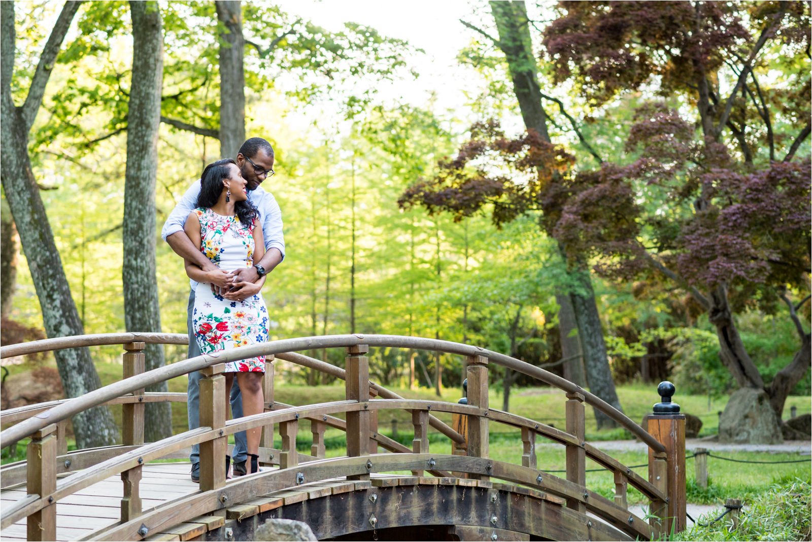 japanese-gardens-japanesegardens-engagement-images-maymont-park-italian-japanese-gardens-richmond-virginia-rva-va-focus-on-joy-photography-african-american-couple-white-dress-colorful-flowers-blue-polo-shirt-richmond-bridge