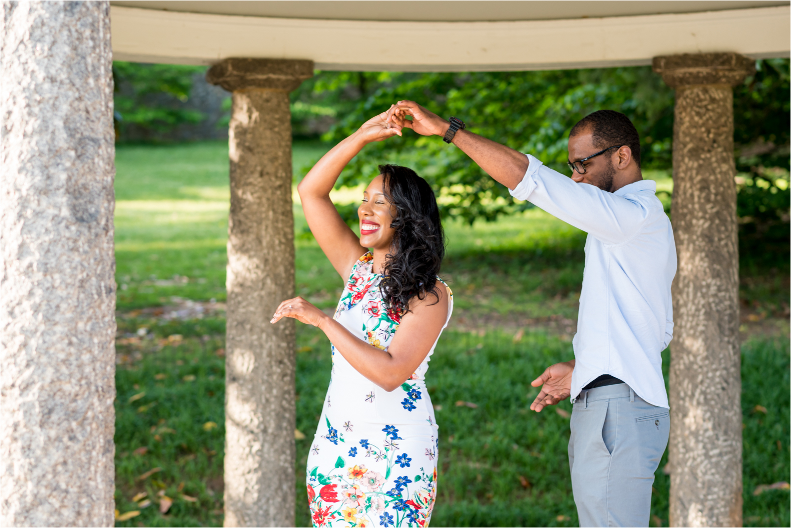 italian-gardens-engagement-images-maymont-park-italian-japanese-gardens-richmond-virginia-rva-va-focus-on-joy-photography-african-american-couple-white-dress-colorful-flowers-blue-polo-shirt-richmond