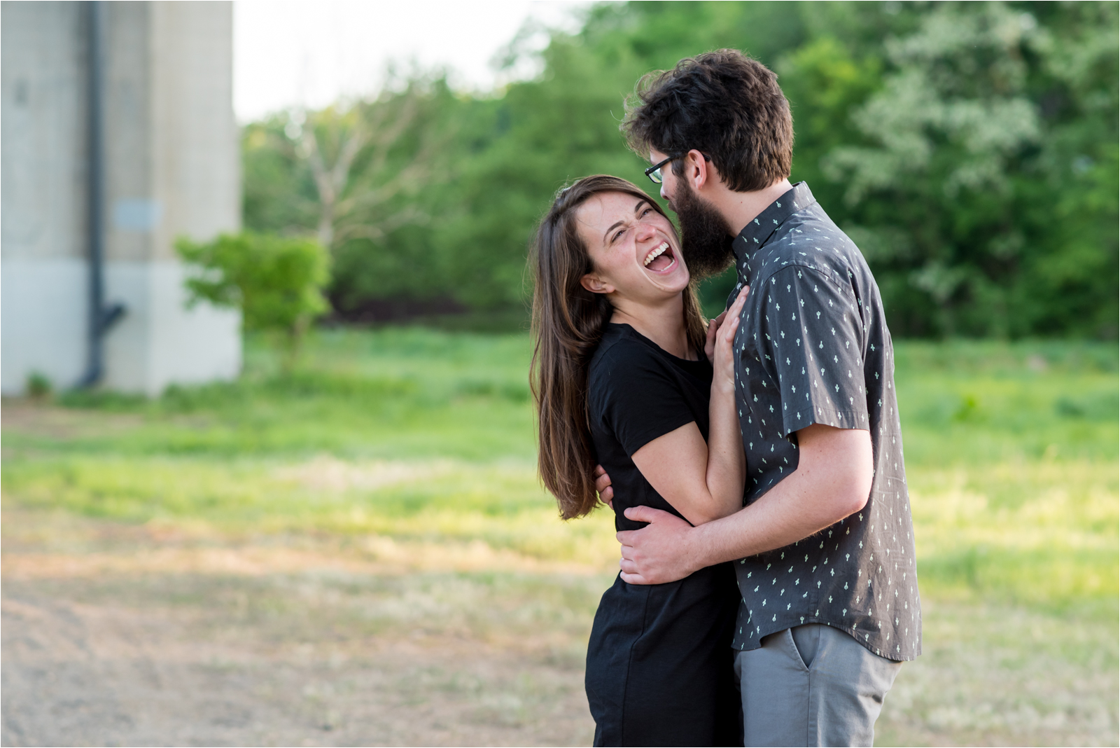engagement-session-belle-isle-richmond-virginia-rva-va-focus-on-joy-photography-jessica-capozzola-man-woman-navy-cactus-shirt-black-dress-nude-heels-embracing-engaged-fiance-husband-wife